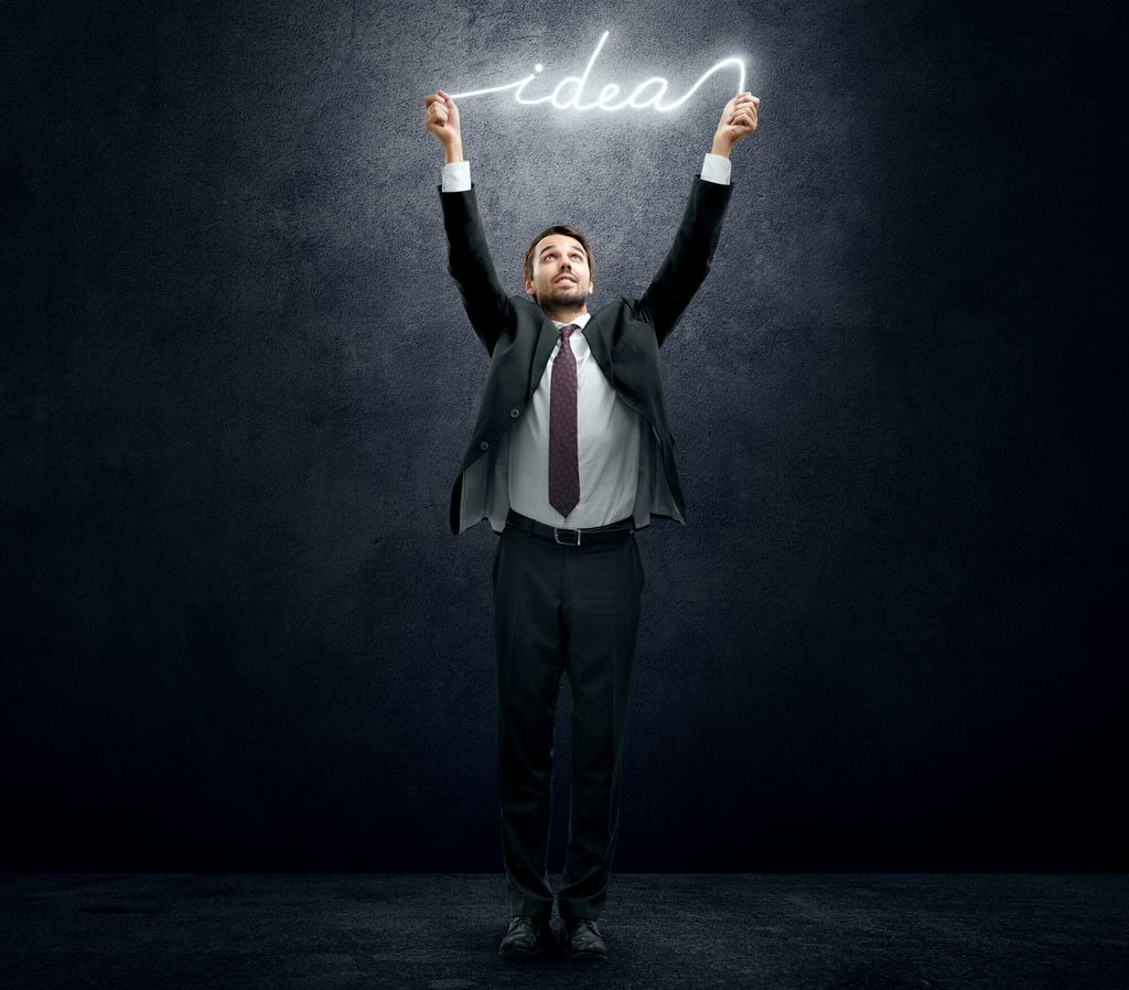 Businessman holding luminous idea